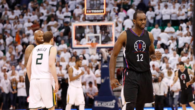 LA Clippers forward Luc Mbah a Moute (12) reacts to beating the Utah Jazz 111-106 in Game 3 of the first round of the 2017 NBA Playoffs.