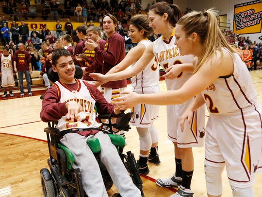 """Javier Casas of the McCutcheon Unified team is introduced at the start of the Champions Together Unified basketball game Friday, December 18, 2015, at McCutcheon High School. Special needs students from Harrison and McCutcheon took part in the game. The slogan for the game was """"Spread the word to end the word."""" Students are asked to stop using the word """"retarded,"""" which has been found to be hurtful to special needs students."""