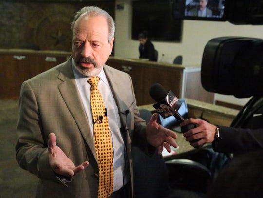Mayor Oscar Leeser talks to the media after City Council
