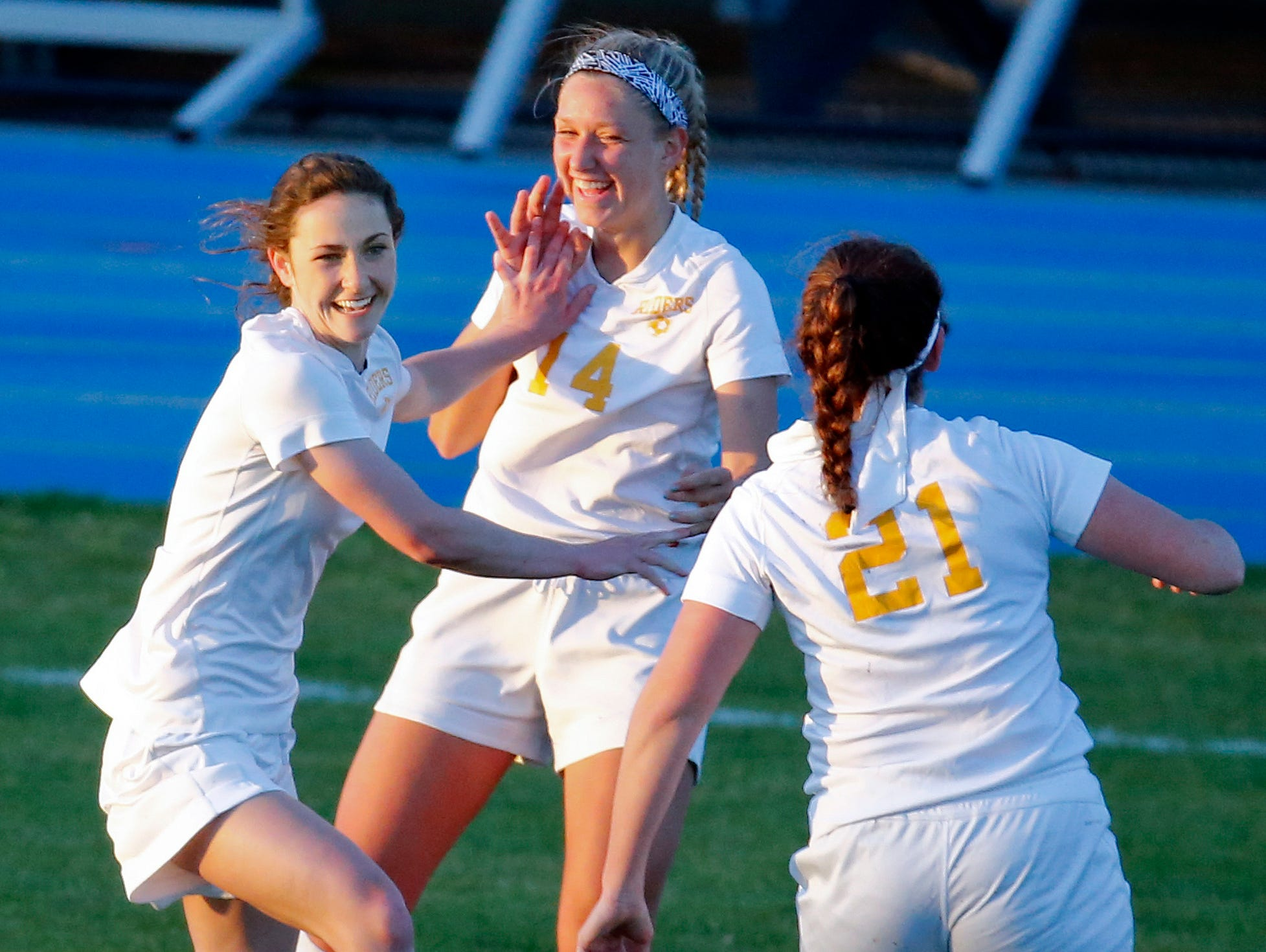 Caesar Rodney's (from left) Aleya Cummings, Kimberly Glasser and Victoria Sebastian celebrate the Riders' go-ahead goal in the second half of their 2-1 win at Caesar Rodney High School Friday. Cummings netted both goals for Caesar Rodney.