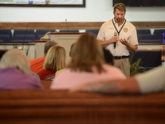 Chaplain David Rushlow offers words of hope to members of the Selmer community during a community counseling session at Cypress Creek First Baptist Church in Selmer on Monday.