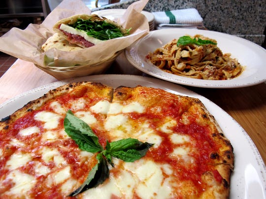 Pizza, pasta and sandwiches at the new Mino pizzeria, ristorante and bar at 1100 Sixth Ave. S., near Tin City in Naples.