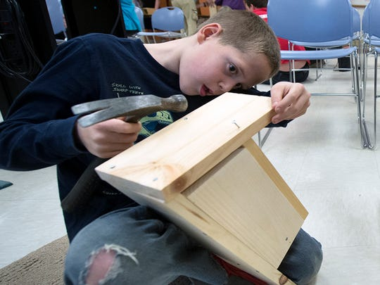 Chase Gundel, age 8, of Springfield Township builds a bluebird box during a bluebird program at Nixon County Park.