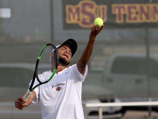 Midwestern State's Angel Palacios serves in his singles