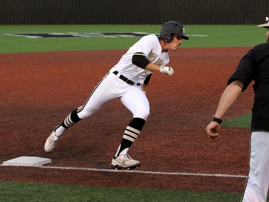Henrietta's Jayson Nixon rounds third on the way home