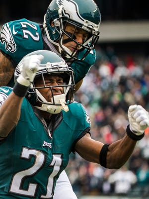 Eagles cornerbacks Leodis McKelvin (No. 21) and Nolan Carroll II (No. 22) celebrate after McKelvin defended a pass intended for Washington receiver Jamison Crowder in the first quarter of the Eagles 27-22 loss to Washington at Lincoln Financial Field in Philadelphia, Pa. on Sunday afternoon.