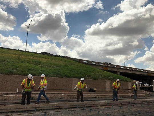 A construction crew with O. Trevino Construction works on the inside lane of South Danville Drive on Wednesday, Aug. 23, 2017.