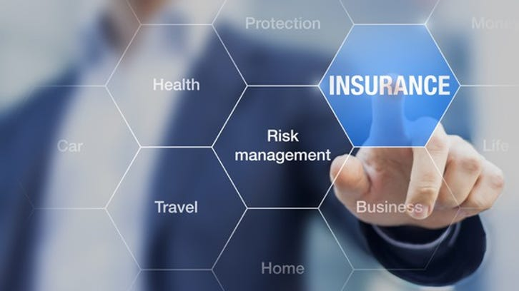 "Businessman pointing toward ""insurance"" on a screen."