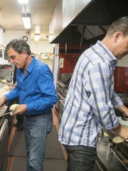 Father Tomaso and son Joey Maggiore both cook and run