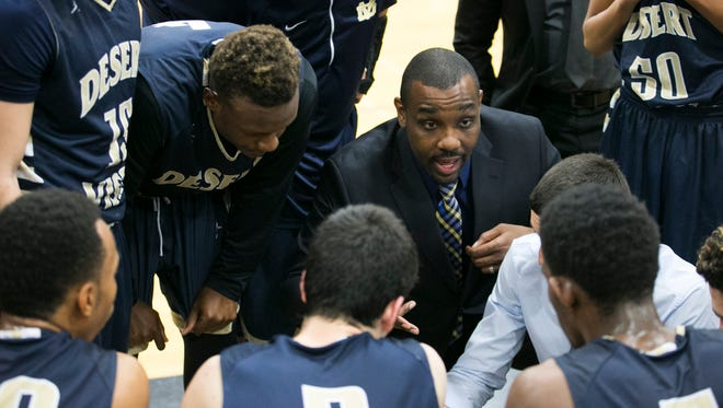 Phoenix Desert Vista coach Tony Darden talks with his team during the second half of the Division I super sectional first-round boys basketball game against Central on Feb. 11.