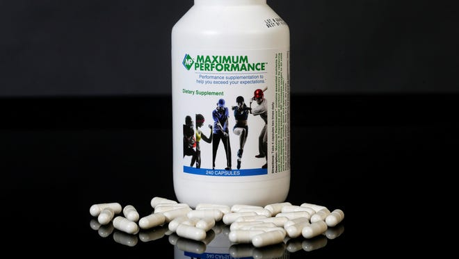 A bottle of pills from Maximum Performance.