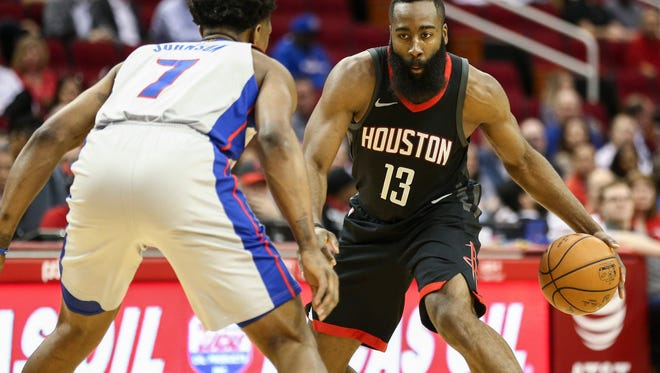 Rockets guard James Harden (13) dribbles as Pistons forward Stanley Johnson (7) defends during the first quarter on Thursday, March 22, 2018, in Houston.