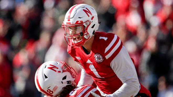 Nebraska wide receiver Jordan Westerkamp (1) is hoisted by offensive lineman Nick Gates (68) after he caught a touchdown pass against Maryland during the first half of an NCAA college football game in Lincoln, Neb., Saturday, Nov. 19, 2016. (AP Photo/Nati Harnik)