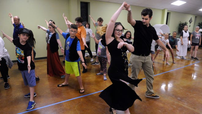 "Andy Searcy playing Lumiere, twirls Kelsey Gwilt during rehearsal for ""Beauty and the Beast"" on Aug. 1. The musical will be performed Friday through Sunday by the Clyde Center for the Performing Arts."