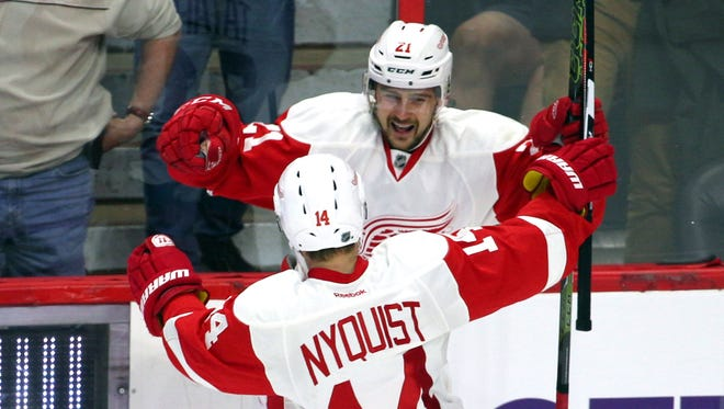 Nov 16, 2015; Ottawa, Ontario, CAN; Detroit Red Wings left wing Tomas Tatar (21) celebrates his a goal against Ottawa Senators with teammate center Gustav Nyquist (14) during an overtime period at Canadian Tire Centre.