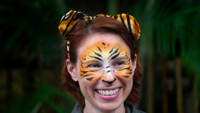 In this March 7, 2015 photo, Stacey Konwiser smiles during the dedication of the new tiger habitat at the Palm Beach Zoo in West Palm Beach, Fla.