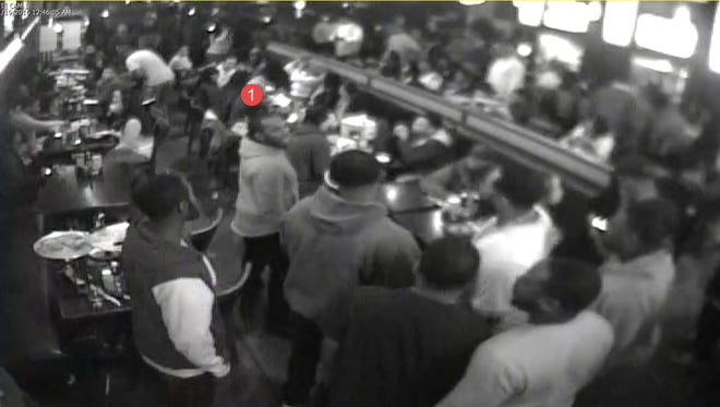 Southfield police released photos of one of two suspects involved in a shooting Saturday at Bar 7.