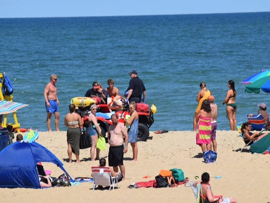 A man is carried off the Ocean City beach on Tuesday,