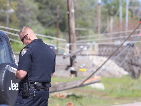 A Redding police officer investigates a crash that
