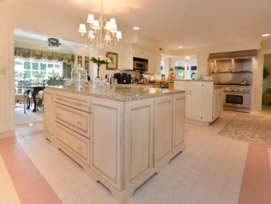 The kitchen offers two center islands with granite stone countertops.