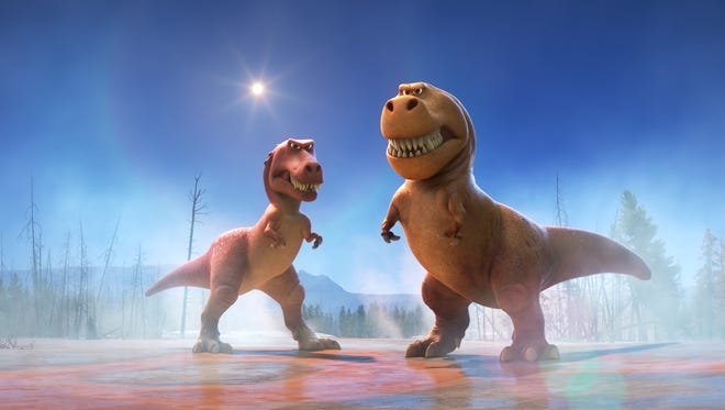 "This image released by Pixar-Disney shows characters Ramsey, voiced by Anna Paquin, left, and Nash, voiced by A.J. Buckley, in a scene from ""The Good Dinosaur."" The animated movie opened in U.S. theaters on Nov. 25, 2015. (Pixar-Disney via AP)"