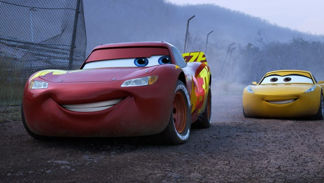 "This image released by Disney shows Lightning McQueen, voiced by Owen Wilson, left, and Cruz Ramirez, voices by Cristela Alonzo, in a scene from ""Cars 3."""
