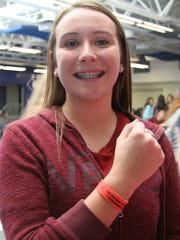 Junior Dana Evans was one of several students pledging for Red Ribbon Week on Monday.