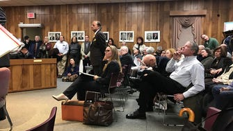 Community members pack the room during the Jan. 16 Zoning Board meeting in Demarest to hear details of a proposed 149-unit assisted living facility. Amba Sharma, the president of developer Karp, LLC, stands second from the left in the first row.