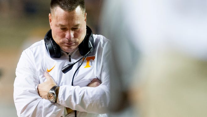 Tennessee Head Coach Butch Jones wals along the sideline during an game between Tennessee and Southern Miss at Neyland Stadium in Knoxville, Tennessee, on Saturday, Nov. 4, 2017.