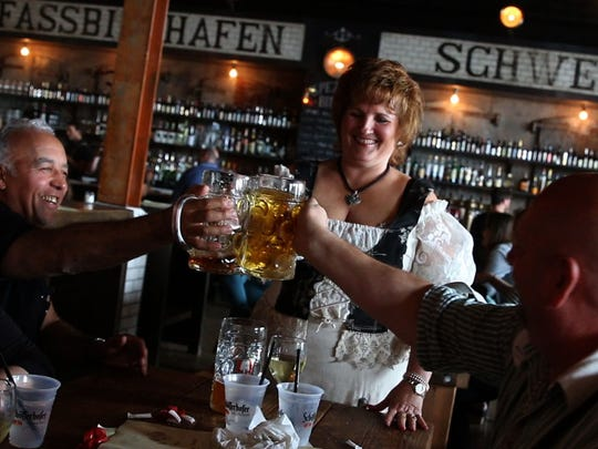 Patrons raise a glass at the Asbury Festhalle and Biergarten on May 9.
