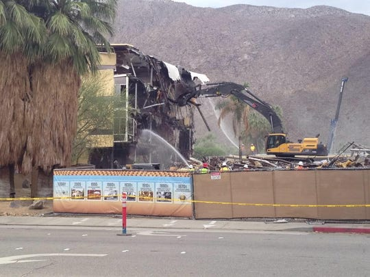 An excavator pulls at the Spa Resort Hotel. It was demolished to make room for a new hotel on Tahquitz Canyon Way, between Indian Canyon Drive and Calle Encilia.