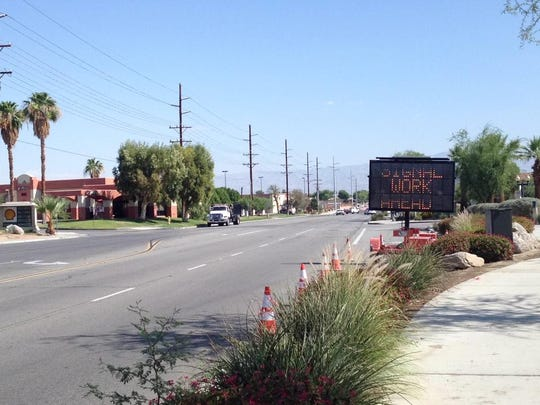 A sign warns drivers of contruction on Adams Street at Corporation Center Drive in La Quinta. Construction begins Monday on building a fourway intersection with a traffic signal.