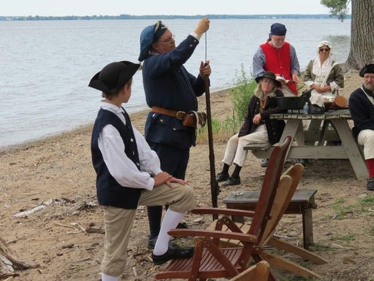 Thomas Hurlbut from Ontario gets ready to do a musket demonstration at St. Anne's Shrine.