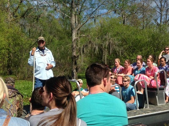 Captain Tucker Friedman talks about the Basin's ecosystem during a boat tour.
