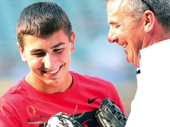 Nate Meyer and Urban Meyer at Ohio State's Friday Night Lights event (Photo: YouTube screen shot)