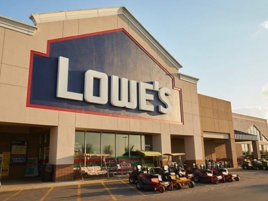 Lowe's store as seen from front, with various equipment for sale.