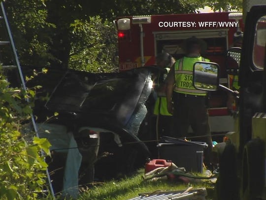 The Vermont State Police investigate the scene of a Monday afternoon car crash that injured former FBI director Louis B. Freeh.