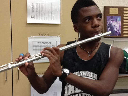 Mason High School junior Anthony Scoburgh practices the flute after classes as a member of the Marching Comets band.