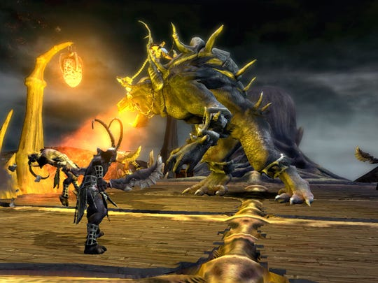 """Hopping aboard one of the large beasts in the center allows you to fight hordes of enemies in """"Dante's Inferno."""""""