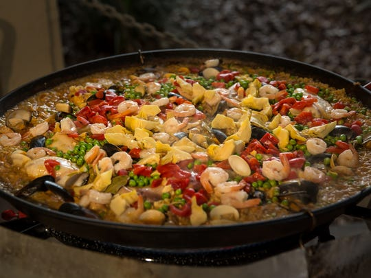 Ken Gluckman specializes in creating a variety of authentic Spanish paellas.