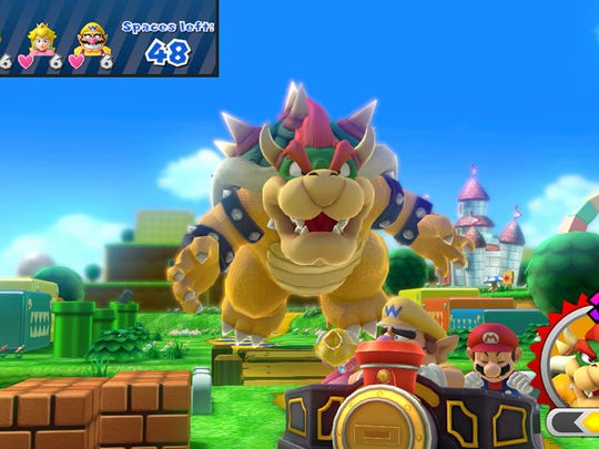 """""""Mario Party 10"""" adds """"Bowser Party"""" mode, which has you chasing up to four hapless players on the game board as the Koopa king."""