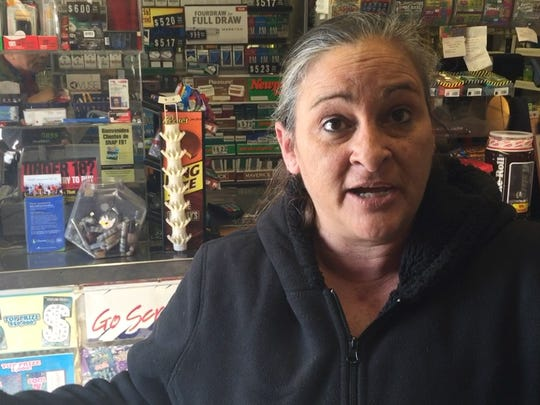 "Susan Whitzel, a Maryland Eastern Shore resident who works for a retail goods distributor, said during a stop in a Marydel, Delaware, shop that she considers presidential changes to immigration law ""illegal."""