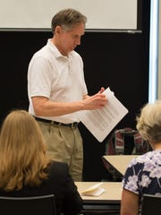 Nick Wasileski, president of the Delaware Coalition For Open Government passes out paperwork during their meeting at Woodlawn Library in Wilmington.