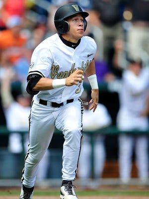 Vanderbilt Jeren Kendall watches his two-run walk-off home run against Cal State Fullerton during the ninth inning on June 15, 2015. Vanderbilt won 4-3.