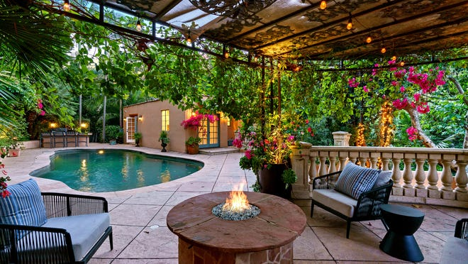 The actor Kunal Nayyar and his wife, model-designer Neha Kapur, are asking $3.995 million for their compound, which spans half an acre in Los Angeles' Hollywood Hills. The Mediterranean villa-style main house and two guesthouses are on the leafy property. Courtyards, patios and a swimming pool with a separate pool house fill out the grounds.