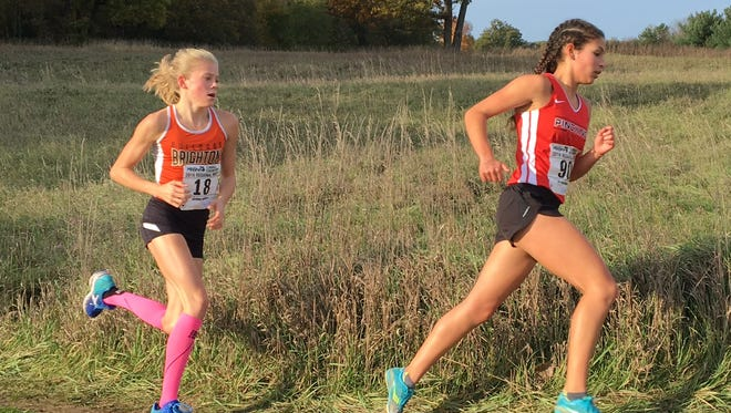 Pinckney's Mia Garcia (right) and Brighton's Lindsey Witte will be at the front of the pack all season after making an impact as freshmen.