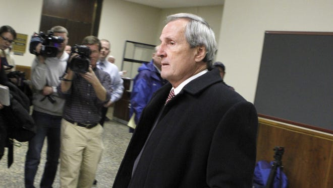 Defendant Robert Wiesner leaves court following a hearing in the LDC corruption case in Monroe County Court Wednesday, Dec. 18, 2013.
