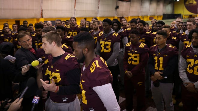 Minnesota players address the media after the decision to suspend 10 of their teammates.