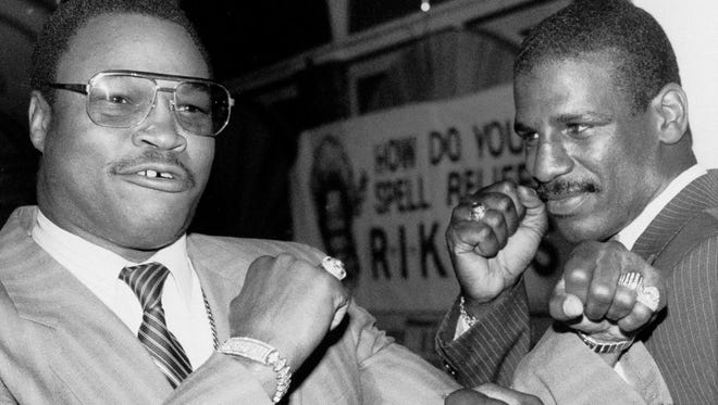 Larry Holmes, left, and Michael Spinks hold up their fists in New York, July 23, 1985 during a promotion for their upcoming fight. During the Sept. 21 heavyweight championship fight in Las Vegas. Spinks won by unanimous decision to become the first lightweight to win the heavyweight title in nearly 80 years.