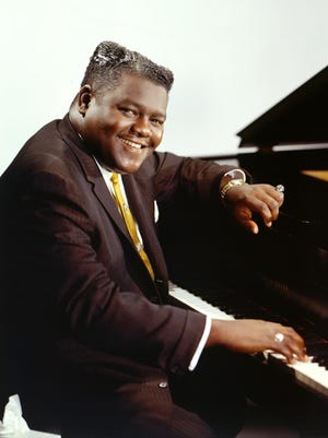 Fats Domino, known for songs like 'I'm Walkin' and Blueberry Hill,' was 89 years old.